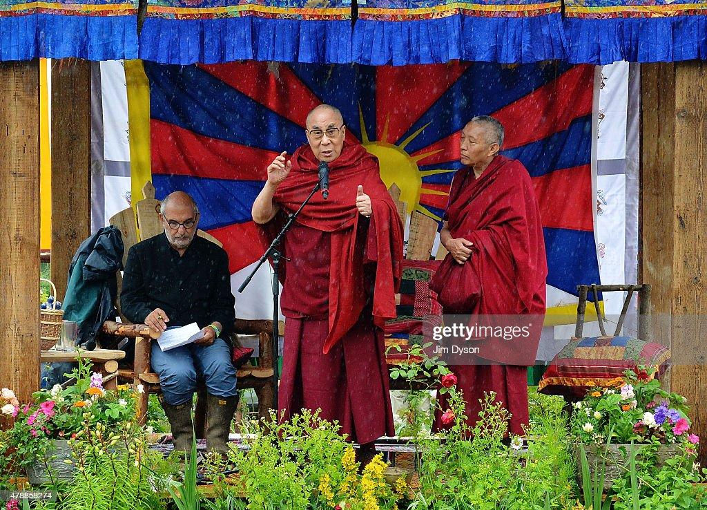 His holiness the Dalai Lama speaks during the third day of Glastonbury Festival at Worthy Farm Pilton on June 28 2015 in Glastonbury England