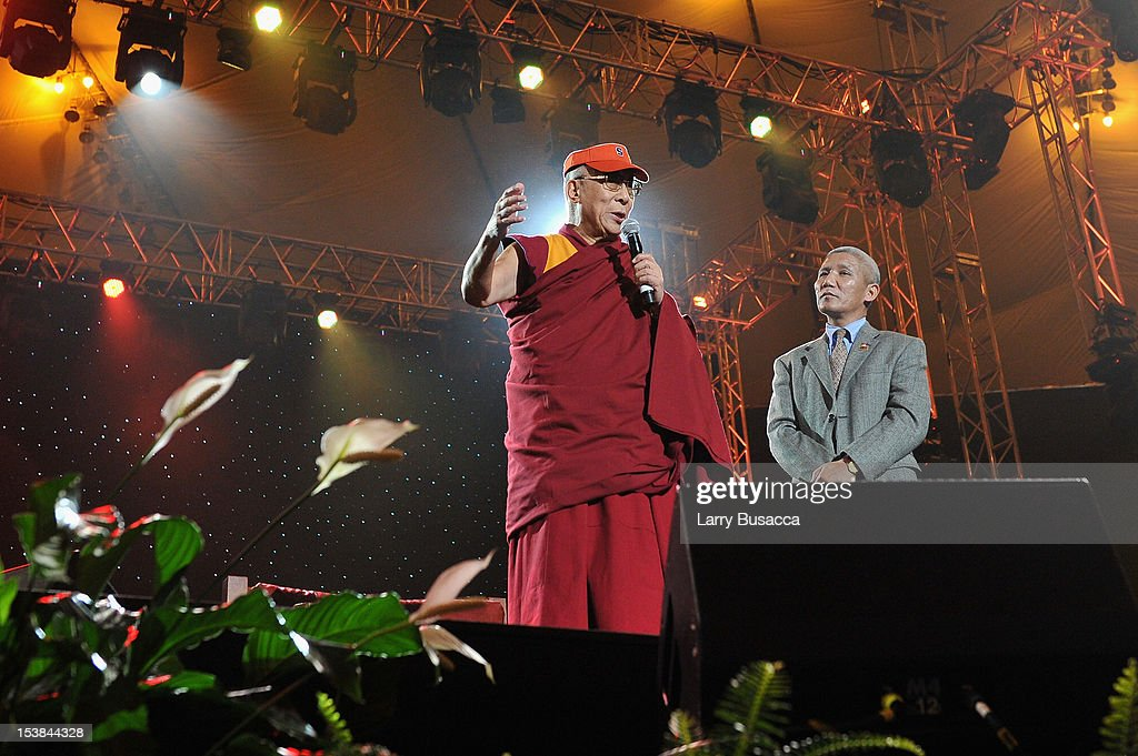 His Holiness the Dalai Lama speaks onstage at the One World Concert at Syracuse University on October 9 2012 in Syracuse New York