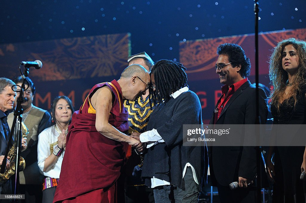 His Holiness the Dalai Lama speaks with <a gi-track='captionPersonalityLinkClicked' href=/galleries/search?phrase=Whoopi+Goldberg&family=editorial&specificpeople=202463 ng-click='$event.stopPropagation()'>Whoopi Goldberg</a> and Andy Madadian onstage at the One World Concert at Syracuse University on October 9, 2012 in Syracuse, New York.