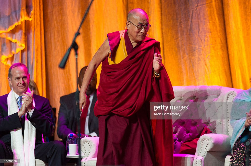 His Holiness the Dalai Lama walks onstage during his 80th birthday celebration and Global Compassion Summit at Honda Center on July 5, 2015 in Anaheim, California.