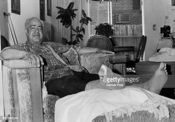 His Injured Feet Propped Up Herbert Porter Rests In His Home He received broken right heel and a fracture of the left foot when he was pushed down...