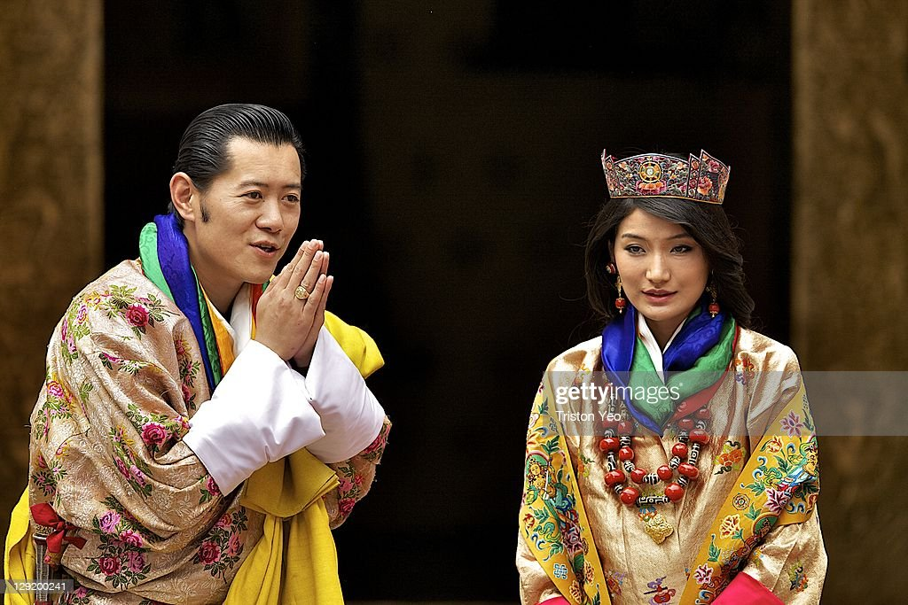 His majesty King Jigme Khesar Namgyel Wangchuck (L), 31 with Queen Ashi Jetsun Pema (R), 21 greeting the media after the wedding ceremony on October 13, 2011 in Punakha, Bhutan. King Jigme Khesar Namgyel Wangchuck and Queen of Bhutan Ashi Jetsun Pema Wangchuck wed in Bhutan's historic 17th century Punakha Dzong the same venue that hosted the King's historical coronation ceremony in 2008. The marriage of popular, Oxford-educated king was celebrated throughout the country's capital and countryside for several days.