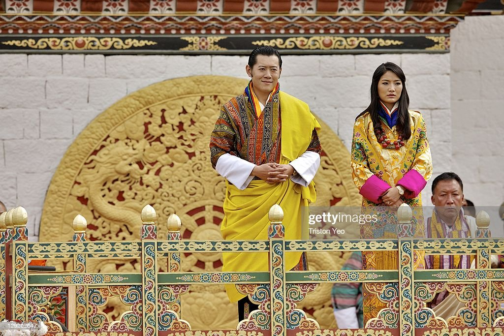 His Majesty, King <a gi-track='captionPersonalityLinkClicked' href=/galleries/search?phrase=Jigme+Khesar+Namgyel+Wangchuck&family=editorial&specificpeople=737466 ng-click='$event.stopPropagation()'>Jigme Khesar Namgyel Wangchuck</a> (L) and at Her Majesty Queen Ashi Jetsun Pema Wangchuck (R) address well wishers at the Chang Lime Thang stadium on October 15, 2011 in Thimphu, Bhutan. In this final day of wedding celebrations for the royal wedding, more than 50,000 people turned up at the stadium with about 500 performers to entertain the guests.