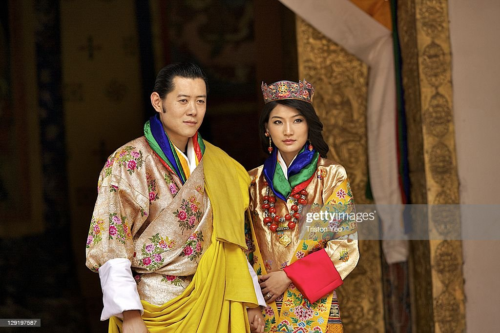 His majesty King <a gi-track='captionPersonalityLinkClicked' href=/galleries/search?phrase=Jigme+Khesar+Namgyel+Wangchuck&family=editorial&specificpeople=737466 ng-click='$event.stopPropagation()'>Jigme Khesar Namgyel Wangchuck</a>, 31, and Queen Jetsun Pema, 21, walk out after their marriage ceremony is completed on October 13, 2011 in Punakha, Bhutan. The popular Oxford-educated king's ceremony will be followed by celebration in the capital and countryside.