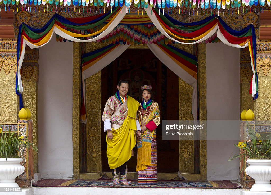 His majesty King <a gi-track='captionPersonalityLinkClicked' href=/galleries/search?phrase=Jigme+Khesar+Namgyel+Wangchuck&family=editorial&specificpeople=737466 ng-click='$event.stopPropagation()'>Jigme Khesar Namgyel Wangchuck</a>, 31, holds his Raven crown as he and the Queen Jetsun Pema, 21, walk out after their marriage ceremony is completed on October 13, 2011 in Punakha, Bhutan. The Dzong is the same venue that hosted the King's historic coronation ceremony in 2008. The Oxford-educated king is popular in the country and the ceremony will be followed by celebration in the capital and countryside.