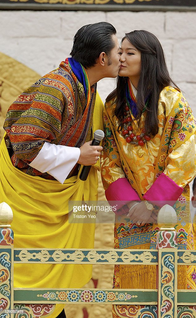 His Majesty, King <a gi-track='captionPersonalityLinkClicked' href=/galleries/search?phrase=Jigme+Khesar+Namgyel+Wangchuck&family=editorial&specificpeople=737466 ng-click='$event.stopPropagation()'>Jigme Khesar Namgyel Wangchuck</a> (L) kisses Her Majesty Queen Ashi Jetsun Pema Wangchuck (R) at the Chang Lime Thang stadium on October 15, 2011 in Thimphu, Bhutan. In this final day of wedding celebrations for the royal wedding, more than 50,000 people turned up at the stadium with about 500 performers to entertain the guests.