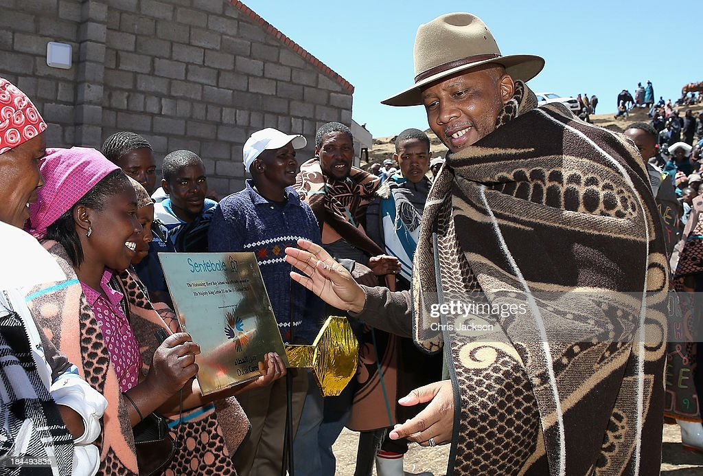 His Majesty King <a gi-track='captionPersonalityLinkClicked' href=/galleries/search?phrase=Letsie+III&family=editorial&specificpeople=572600 ng-click='$event.stopPropagation()'>Letsie III</a> of Lesotho is presented with a plaque at the opening ceremony of the new Sentebale Mateanong Herd Boy School on October 14, 2013 in Mokhotlong, Lesotho. Sentebale provides healthcare and education to the vulnerable children of Lesotho, a land-locked mountainous South African Kingdom. The charity was started in 2006 by Prince Seeiso of Lesotho and Prince Harry.