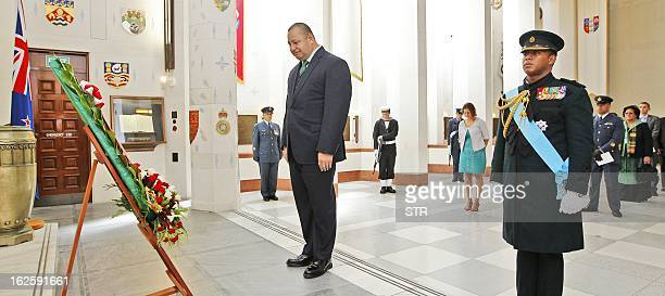His Majesty King Tupou VI of Tonga pays his respects after a wreathlaying ceremony at the National War Memorial in Wellington on February 25 2013...