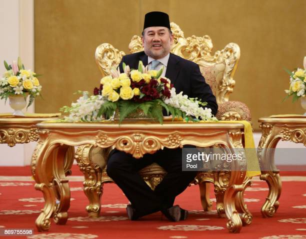 His Majesty The Yang diPertuan Agong XV Sultan Muhammad V talks with Prince CharlesThe Prince of Wales at his official residence Istana Negara on...