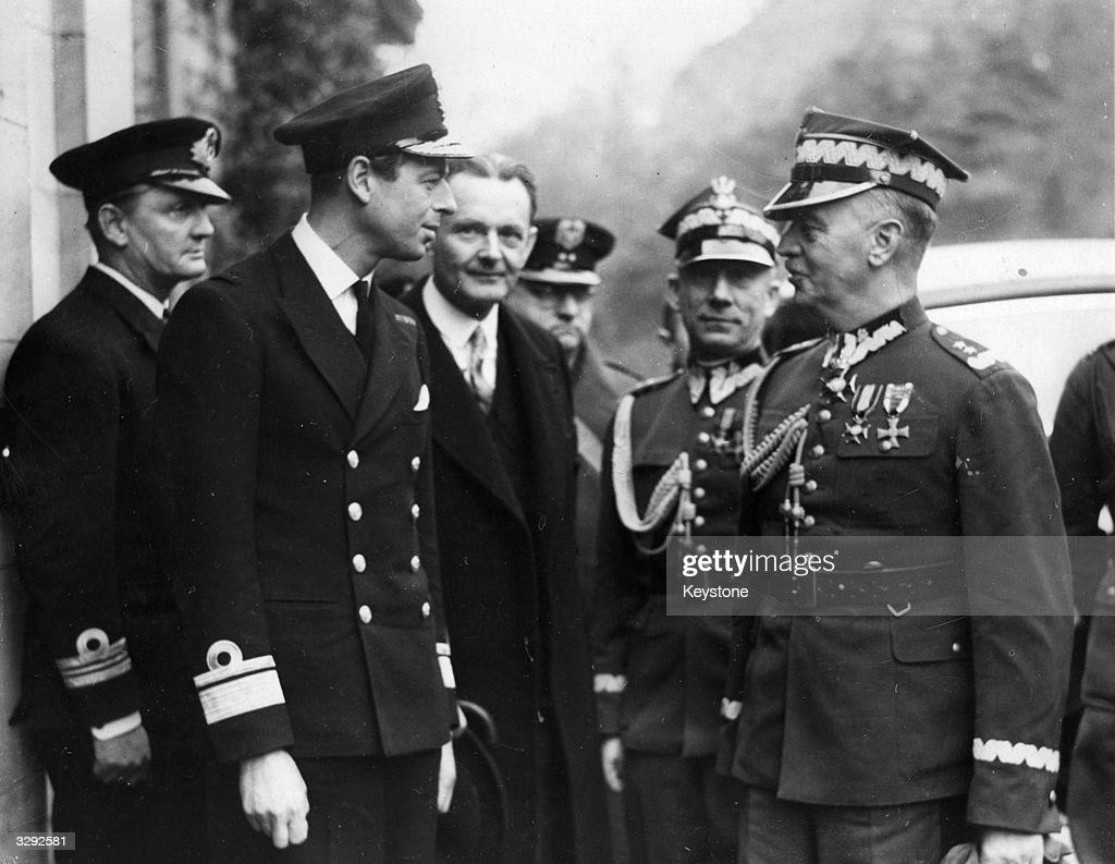 His Royal Highness George Edward Alexander Edmund (1902 - 1942), the Duke of Kent, with the Polish prime minister General Wladyslaw Sikorski, who is presenting decorations to some of Poland's fighting men at a port in Scotland, November 18, 1939.