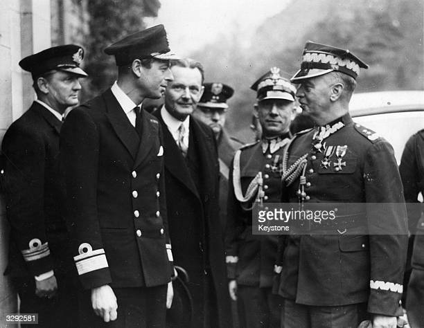 His Royal Highness George Edward Alexander Edmund the Duke of Kent with the Polish prime minister General Wladyslaw Sikorski who is presenting...