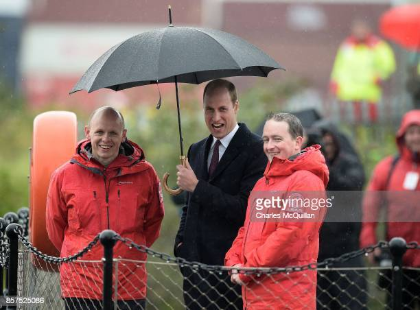 His Royal Highness Prince William the Duke of Cambridge laughs as he is shown a rescue demonstration by the Quayside Response Lifeboat and Rescue...