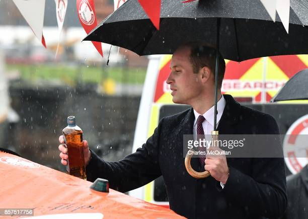 His Royal Highness Prince William the Duke of Cambridge pours a measure of whiskey onto 'Ray of Hope' as he dedicates a new lifeboat to the Lagan...