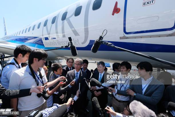 Hisakazu Mizutani Mitsubishi Aircraft Corporation's president is surrounded by journalists front of the third Flight Test Aircraft of Mitsubishi...