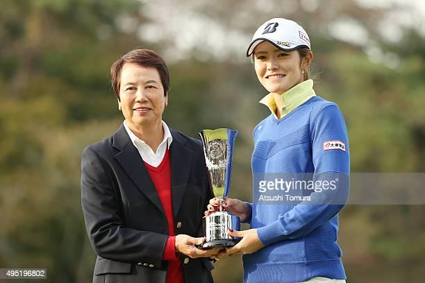 Hisako Higuchi and Ayaka Watanabe of Japan pose with the trophy during the Higuchi Hisako Ponta Ladies at the Musashigaoka Golf Course on November 1...
