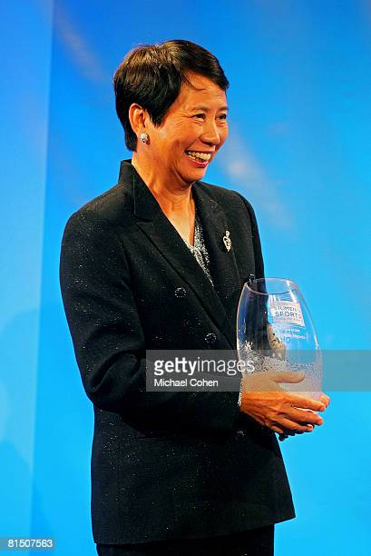 Hisako Higuchi golf legend holds her award during the induction ceremony for the International Women's Sports Hall of Fame at the Sports Museum of...