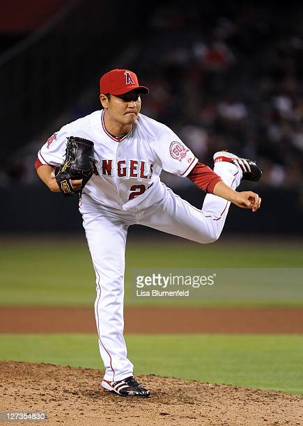 Hisanori Takahashi of the Los Angeles Angels of Anaheim pitches against the Oakland Athletics at Angel Stadium of Anaheim on September 24 2011 in...