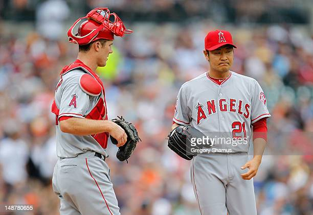 Hisanori Takahashi of the Los Angeles Angels of Anaheim reacts after walking Prince Fielder of the Detroit Tigers next to Bobby Wilson in the seventh...