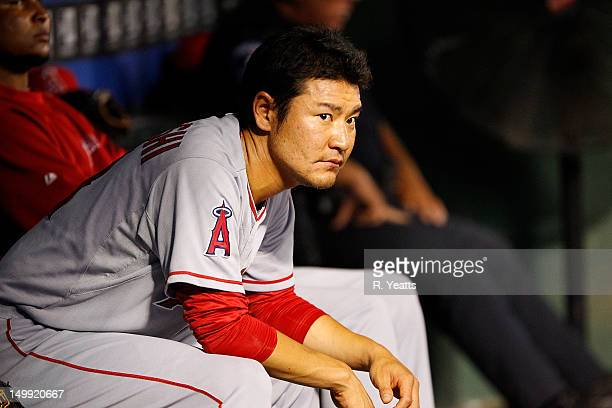 Hisanori Takahashi of the Los Angeles Angels of Anaheim sits in the dugout between innings against the Texas Rangers at Rangers Ballpark in Arlington...