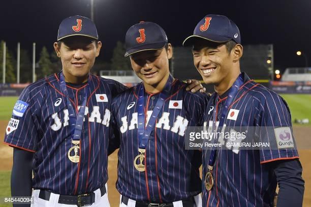 Hisanori Yasuda Kotaro Kiyomiya and Kyota Fujiwara of Japan pose for a picture after beating Canada in the Bronze Medal Game following the WBSC U18...