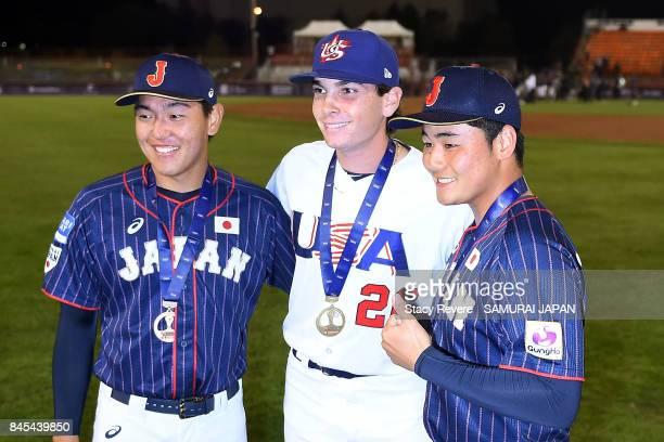 Hisanori Yasuda of Japan Triston Casas of the United States and Kotaro Kiyomiya of Japan pose for a picture following the WBSC U18 Baseball World Cup...