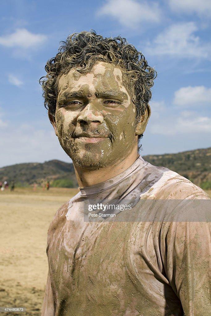Hisapanic Male competing at a 5K Mud Run. : Stock Photo
