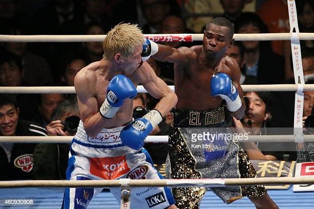 Hisashi Amagasa of Japan and Guillermo Rigondeaux of Cuba exchange punches during the WBA/WBO world super bantamweight bout between Guillermo...