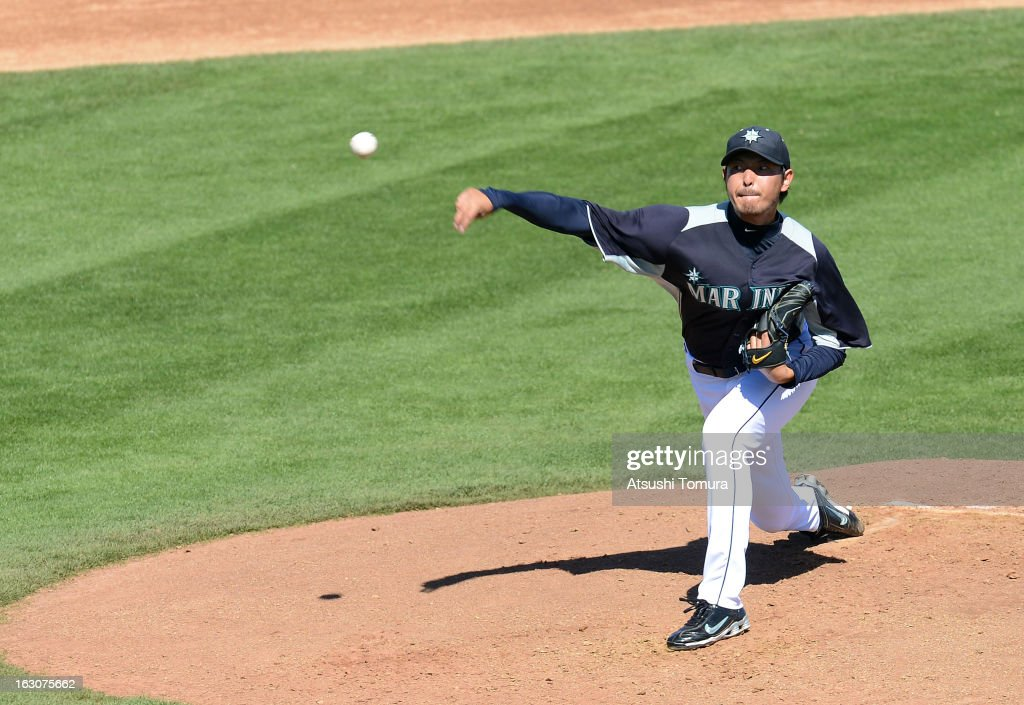 Hisashi Iwakuma #18 of Seattle Mariners throws during the spring training match against Los Angeles Dodgers on March 2, 2013 in Peoria, Arizona.
