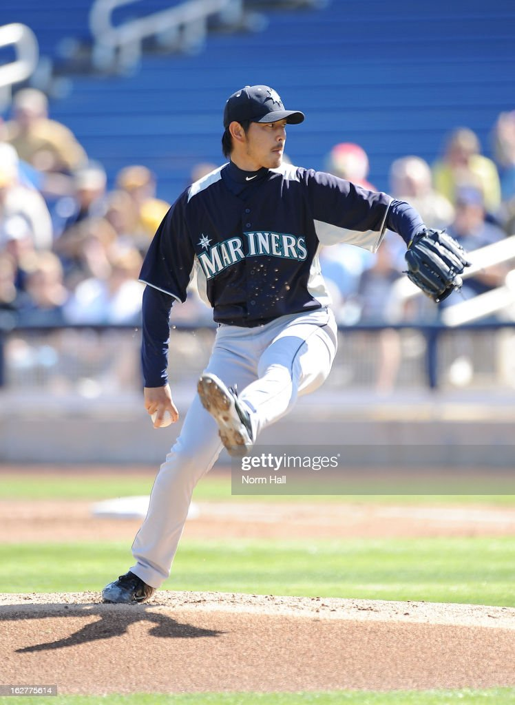 <a gi-track='captionPersonalityLinkClicked' href=/galleries/search?phrase=Hisashi+Iwakuma&family=editorial&specificpeople=5723798 ng-click='$event.stopPropagation()'>Hisashi Iwakuma</a> #18 of the Seattle Mariners delivers a pitch against the Milwaukee Brewers at Maryvale Baseball Park on February 26, 2013 in Maryvale, Arizona.