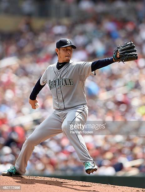 Hisashi Iwakuma of the Seattle Mariners delivers a pitch against the Minnesota Twins during the second inning of the game on August 2 2015 at Target...