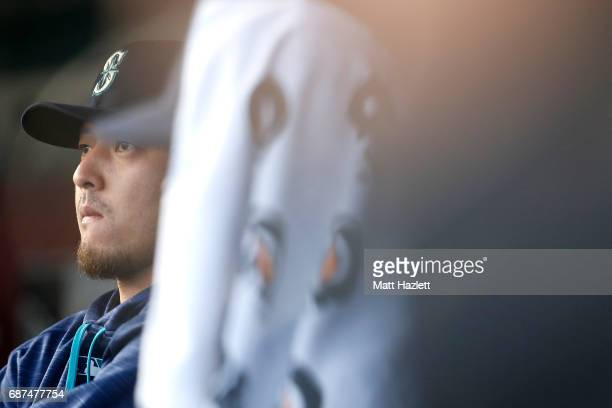 Hisashi Iwakuma of the Seattle Mariners looks on from the dugout against the Washington Nationals during the first inning at Nationals Park on May 23...