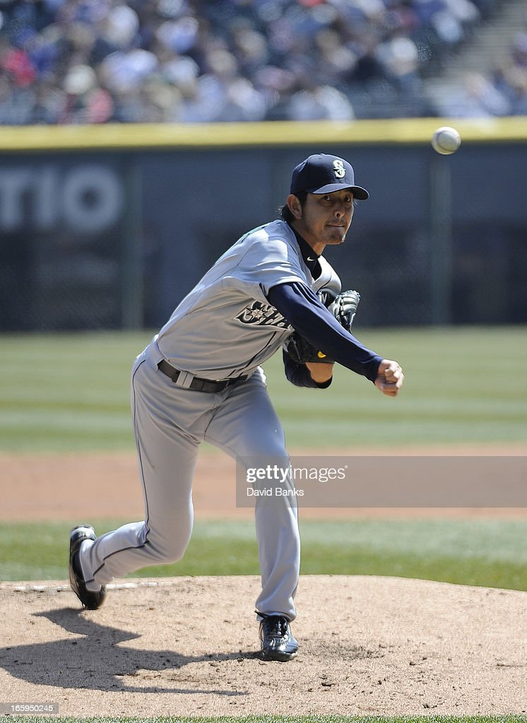 <a gi-track='captionPersonalityLinkClicked' href=/galleries/search?phrase=Hisashi+Iwakuma&family=editorial&specificpeople=5723798 ng-click='$event.stopPropagation()'>Hisashi Iwakuma</a> #18 of the Seattle Mariners pitches against the Chicago White Sox in the first inning on April 7, 2013 at U.S. Cellular Field in Chicago, Illinois.