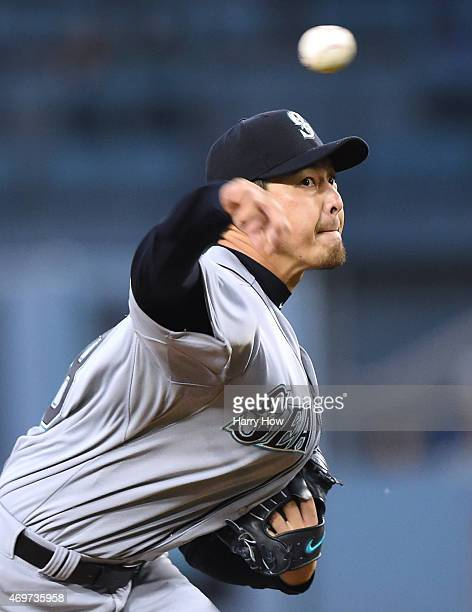 Hisashi Iwakuma of the Seattle Mariners pitches against the Los Angeles Dodgers during the first inning at Dodger Stadium on April 14 2015 in Los...