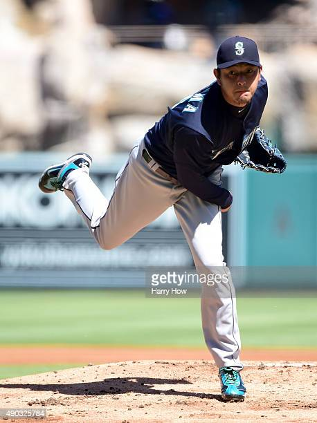 Hisashi Iwakuma of the Seattle Mariners pitches against the Los Angeles Angels during the first inning at Angel Stadium of Anaheim on September 27...