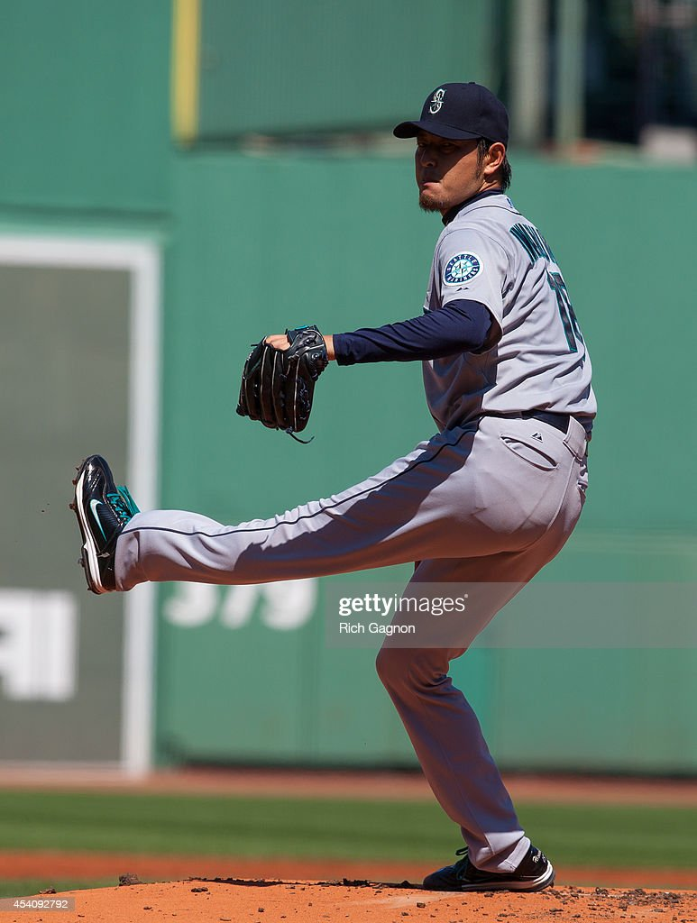 <a gi-track='captionPersonalityLinkClicked' href=/galleries/search?phrase=Hisashi+Iwakuma&family=editorial&specificpeople=5723798 ng-click='$event.stopPropagation()'>Hisashi Iwakuma</a> #18 of the Seattle Mariners pitches during the first inning against the Boston Red Sox at Fenway Park on August 24, 2014 in Boston, Massachusetts.