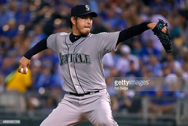 Hisashi Iwakuma of the Seattle Mariners pitches in the first inning against the Kansas City Royals at Kauffman Stadium on September 22 2015 in Kansas...