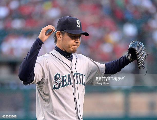 Hisashi Iwakuma of the Seattle Mariners reacts as he leaves the mound after the first inning against the Los Angeles Angels at Angel Stadium of...