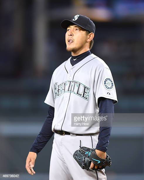 Hisashi Iwakuma of the Seattle Mariners reacts on the mound as he pitches against the Los Angeles Dodgers during the first inning at Dodger Stadium...