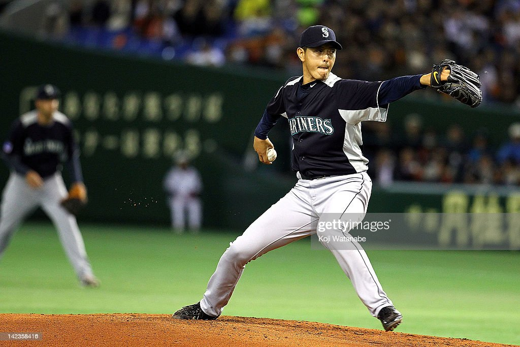 Hisashi Iwakuma of the Seattle Mariners throws during the pre season game between Seattle Mariners and Yomiuri Giants at Tokyo Dome on March 26, 2012 in Tokyo, Japan.