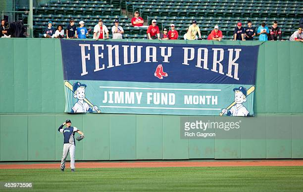 Hisashi Iwakuma of the Seattle Mariners throws from the outfield at Fenway Park before a game against the Boston Red Sox on August 22 2014 in Boston...