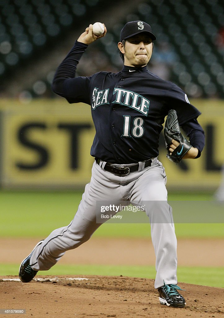 Hisashi Iwakuma #18 of the Seattle Mariners throws in the first inning against the Houston Astros at Minute Maid Park on July 1, 2014 in Houston, Texas.