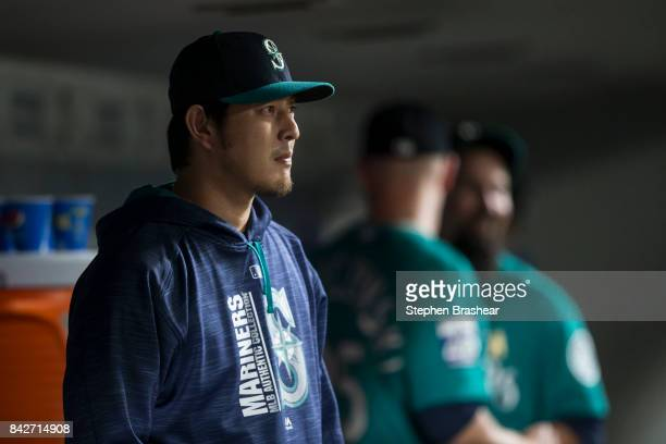 Hisashi Iwakuma of the Seattle Mariners watches play from the dugout during a game against the Oakland Athletics at Safeco Field on September 1 2017...