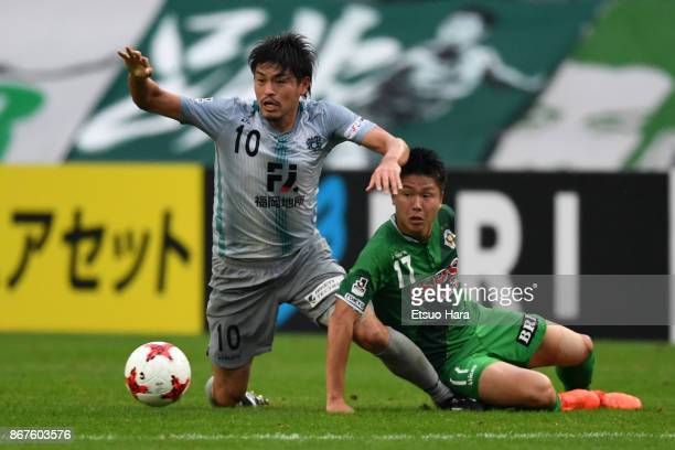 Hisashi Jogo of Avispa Fukuoka and Tatsuya Uchida of Tokyo Verdy compete for the ball during the JLeague J2 match between Tokyo Verdy and Avispa...