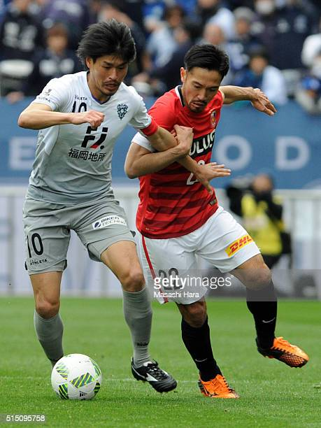 Hisashi Jogo of Avispa Fukuoka and Yuki Abe of Urawa Red Diamonds compete for the ball during the JLeague match between Urawa Red Diamonds and Avispa...