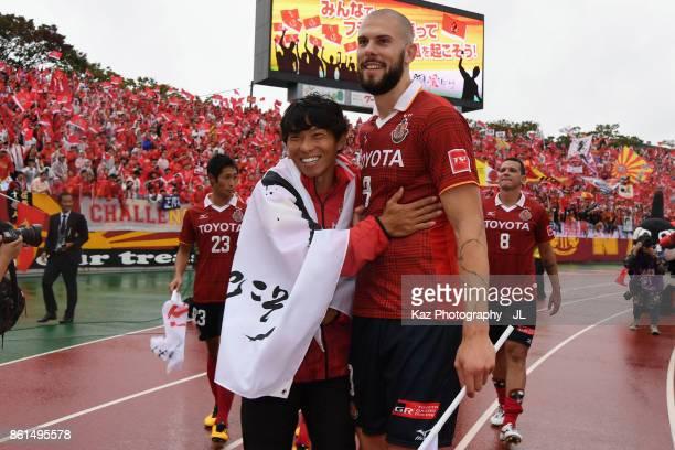 Hisato Sato and Robin Simovic of Nagoya Grampus celebrate their 32 victrory in the JLeague J2 match between Nagoya Grampus and Shonan Bellmare at...
