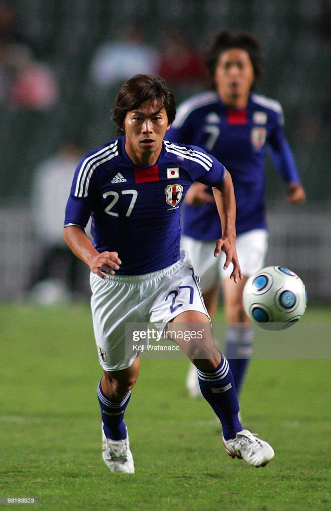 <a gi-track='captionPersonalityLinkClicked' href=/galleries/search?phrase=Hisato+Sato&family=editorial&specificpeople=713823 ng-click='$event.stopPropagation()'>Hisato Sato</a> of Japan in action during AFC Asia Cup 2011 Qatar qualifier match between Hong Kong and Japan at Hong Kong Stadium on November 18, 2009 in Hong Kong, Hong Kong.