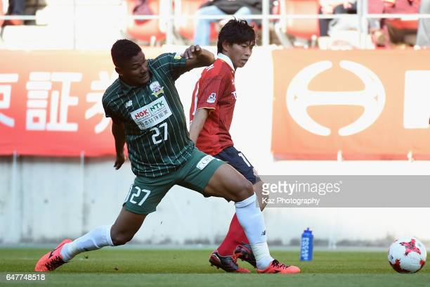 Hisato Sato of Nagoya Grampus and Henik of FC Gifu compete for the ball during the JLeague J2 match between Nagoya Grampus and FC Gifu at Toyota...