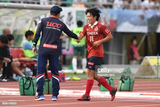 Hisato Sato of Nagoya Grampus shakes hand with Head coach Yahiro Kazama after substituted during the JLeague J2 match between FC GIfu and Nagoya...