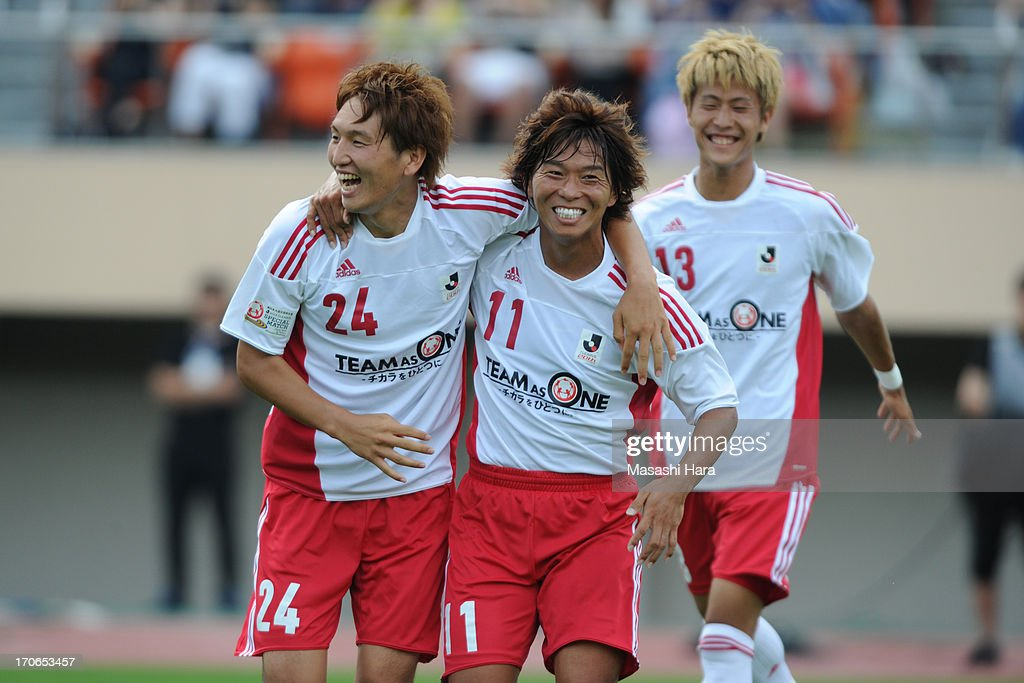 <a gi-track='captionPersonalityLinkClicked' href=/galleries/search?phrase=Hisato+Sato&family=editorial&specificpeople=713823 ng-click='$event.stopPropagation()'>Hisato Sato</a> #11 of Rest of the J.League (R) celebrates the first goal with Genki Haraguchi #24 during the J.League Special Match between J.League Team as One and Rest of the J.League at National Stadium on June 16, 2013 in Tokyo, Japan.