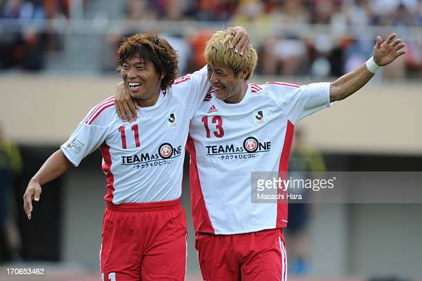 Hisato Sato of Rest of the JLeague celebrates the first goal with Yoichiro Kakitani during the JLeague Special Match between JLeague Team as One and...